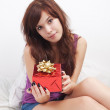 Girl and gift — Stock Photo