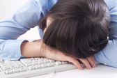 Woman tired at work — Stock Photo