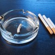 Blue light in the ashtray — Stock Photo #8144580