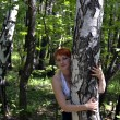 The girl at a birch — Stockfoto