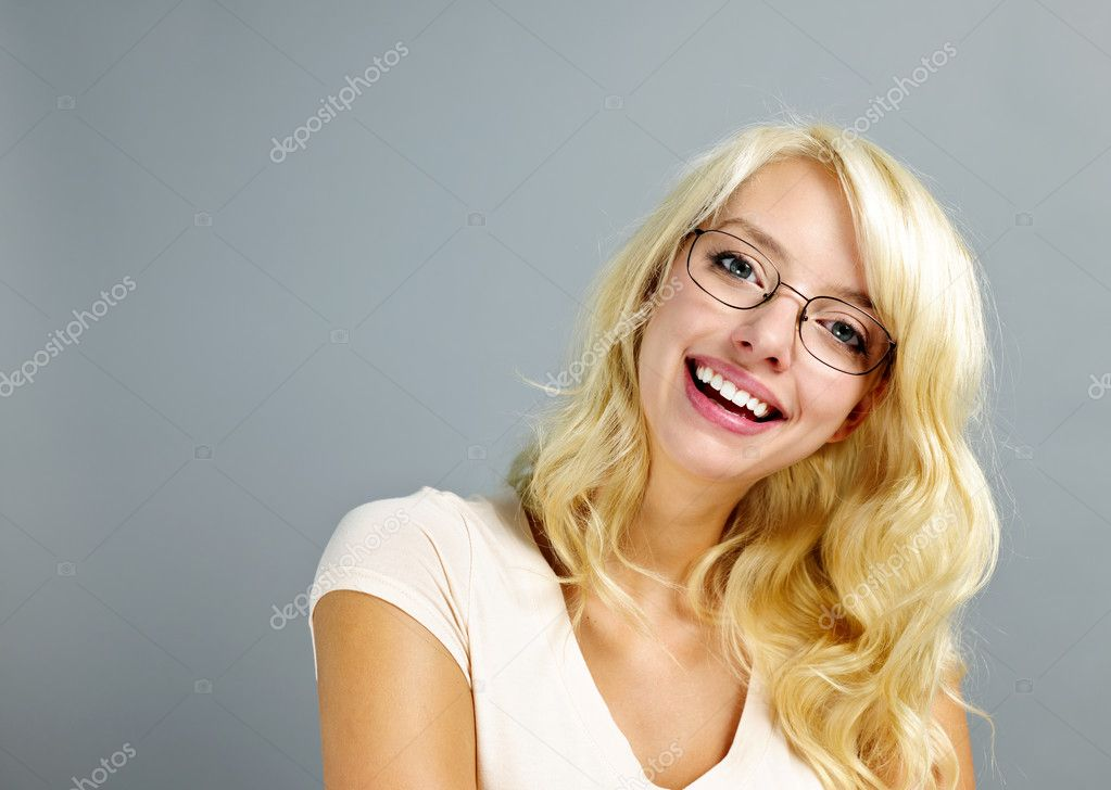 Happy young woman wearing eyeglasses on grey background — Stock Photo #8910394