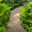 Brick path in landscaped garden - Foto de Stock
