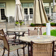 Patio tables and chairs - Stock Photo