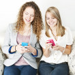 Two women using mobile devices — Stock Photo