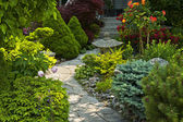 Garden path with stone landscaping — Stock Photo