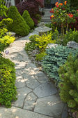 Garden path with stone landscaping — Photo