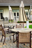Patio tables and chairs — Stock Photo