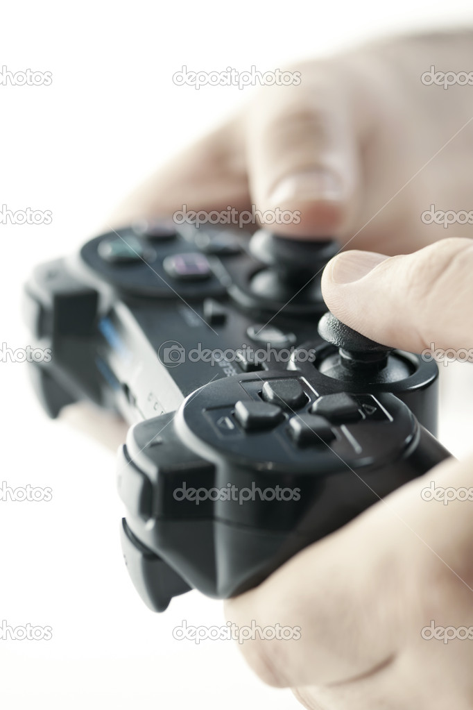 Male hands holding video game controller closeup — Stock Photo #8943778