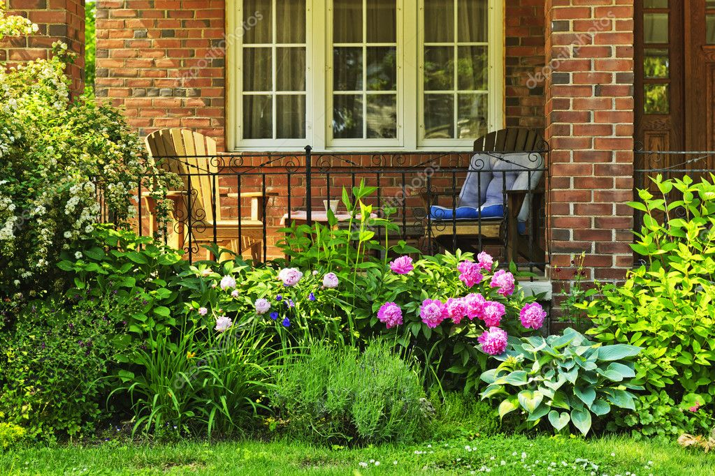 Garden in front of house stock photo elenathewise 8943813 for Small flower garden in front of house