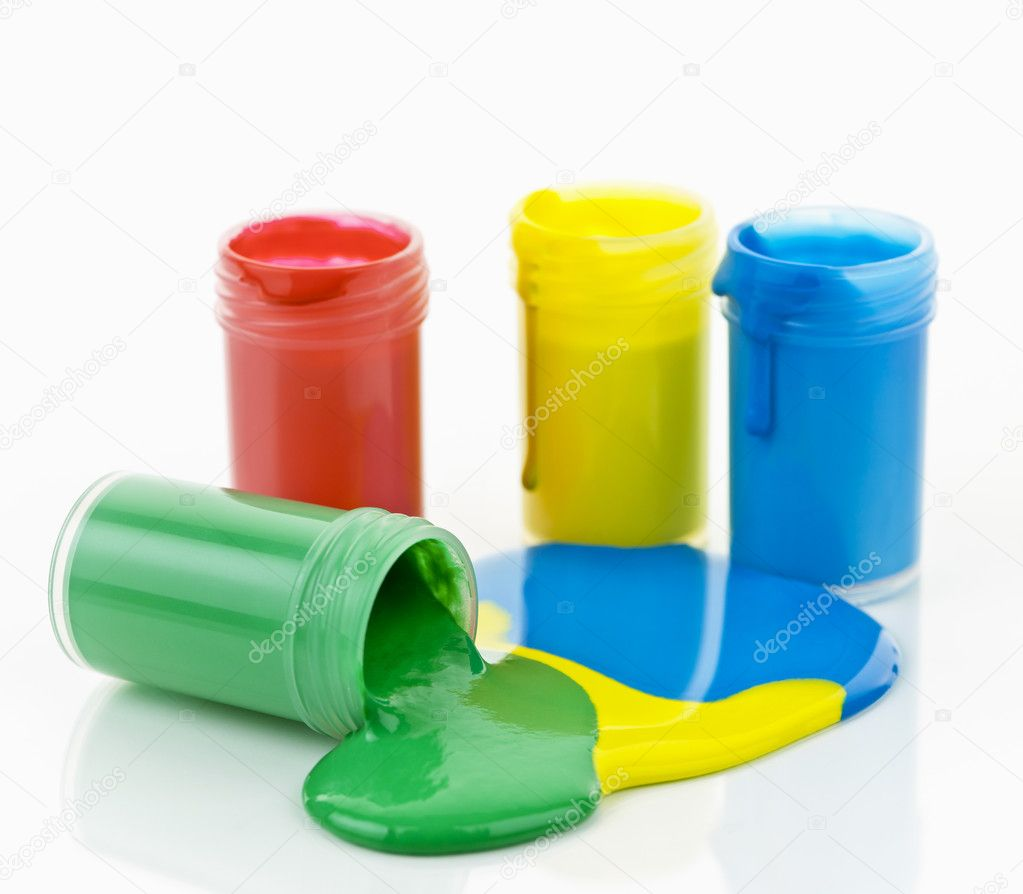 Open containers of paint in primary colors spilled and mixed — Stock Photo #8943885