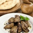 Chicken liver with garlic sauce — Stock Photo