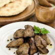 Stock Photo: Chicken liver with garlic sauce