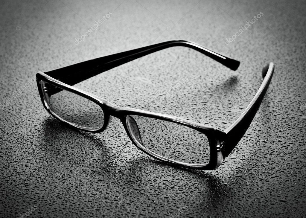Reading glasses on dark wood  Stock Photo #8474377