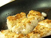Frying white fish — Stock Photo