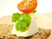 Cracker, soft cheese and tomato — Stock Photo
