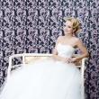 Stock Photo: Bride full length sitting portrait