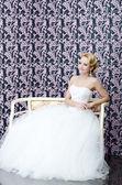 Bride full length sitting portrait — Stock Photo
