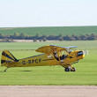 Stock Photo: Piper Cub taxis for takeoff