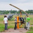 Spectators examine an ultralight autogyro — Stock Photo