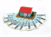 House with money over white background - mortgaging concept — Stock Photo
