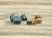 Three Construction site vehicles parked for lunch — Stock Photo