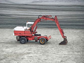 Excavator machine parked on the sand — Stock Photo