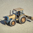 Stock Photo: Grader truck parked on sand