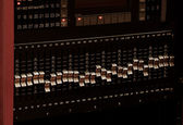 Professional Audio Equipment console in dark - Equalizer close-up — Stock Photo