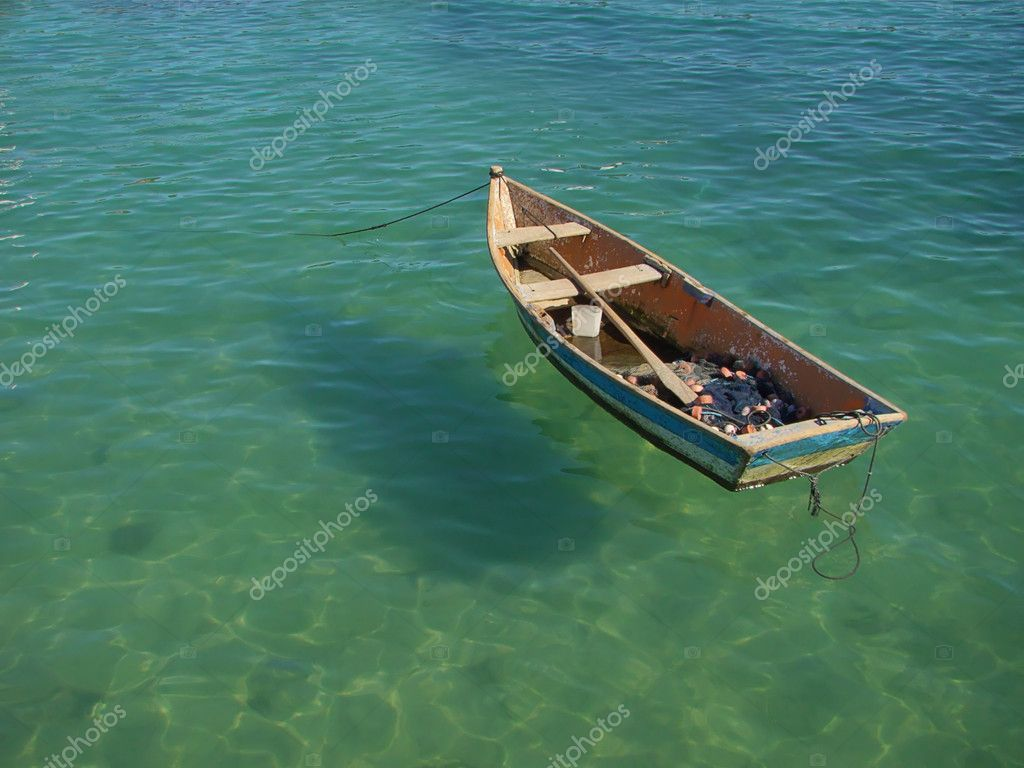 Small row boat floating on the water — Stock Photo #10191813