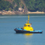 Tug boat navigating a beautiful blue ocean — Stock Photo #10343153