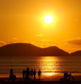 On the beach under a beautiful golden sunset — 图库照片