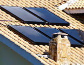 Solar panel on the roof for water heating — Stock Photo