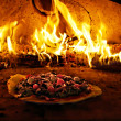 Pizza oven burning in flames — Stock Photo