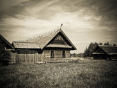 Old wooden house in village — ストック写真