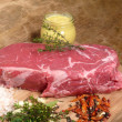 Roast beef with seasoning ingredients - Stock Photo