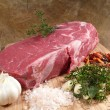 Stock Photo: Roast beef with seasoning ingredients