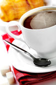 Coffee in white cup with croissants — Stock Photo