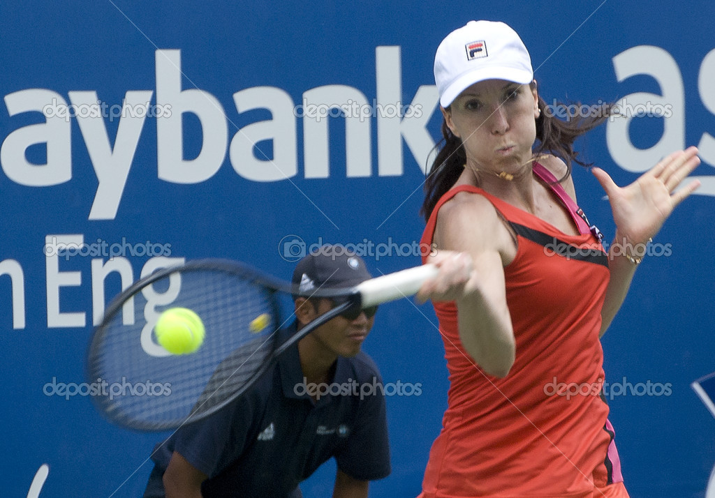 KUALA LUMPUR - MARCH 4: Jelena Jankovic (SRB) returns ball to Petra Martic(CRO) at semi final match, Martic win with 7-6, 5-7, 6-7 during BMW Malaysian Open in Kuala Lumpur, Malaysia on March 4, 2012   Stock Photo #9487551