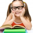 Cute little girl reads a book — Stock Photo