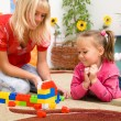 Teacher and child are playing with bricks — Foto de Stock