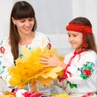 Stock Photo: Mother and child in Ukraininational cloth