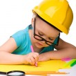Cute little girl draw with marker wearing hard hat — Stock Photo
