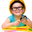 Cute little girl is playing while wearing hard hat — Stock Photo #8356540