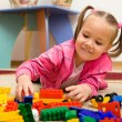 Little girl is playing with toys in preschool - Photo