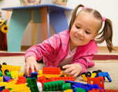 Little girl is playing with toys in preschool — Fotografia Stock