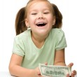 Cute little girl with paper money - dollars — Stock Photo #8370897
