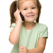 Cute little girl is talking on cell phone — Stock Photo #8370908