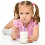 Little girl drinks milk — Stock Photo #8370918