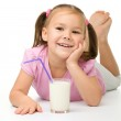 Little girl with a glass of milk — Stock Photo #8370921