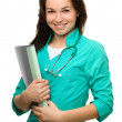 Stock Photo: Young attractive woman wearing a doctor uniform